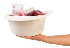 Hand met hoedenhoogtepunt van geld Royalty-vrije Stock Foto