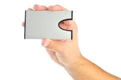 Hand met kaarthouder op wit Stock Afbeeldingen