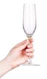 Hand met leeg die glas champagne op een wit wordt geïsoleerd Stock Fotografie