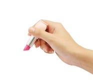 Hand met lippenstift Stock Foto