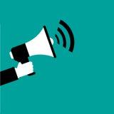 Hand met Megafoon Op een blauwe achtergrond Royalty-vrije Stock Afbeelding