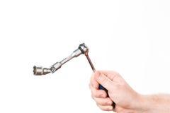 Hand met moersleutel Stock Afbeelding