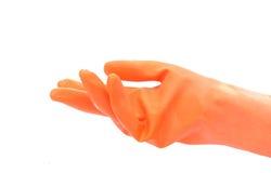 Hand met oranje rubberhandschoen Royalty-vrije Stock Fotografie