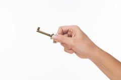 Hand met oude sleutel Stock Foto