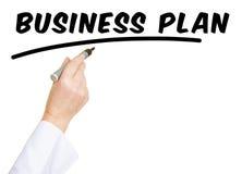 Hand met pen het schrijven het Businessplan van  Stock Foto
