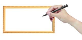 Hand met pen en frame Stock Afbeeldingen