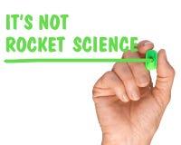 Hand met Pen Writing zijn niet citaat van de raketwetenschap stock fotografie