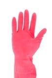 Hand met rode rubberhandschoen Stock Afbeeldingen