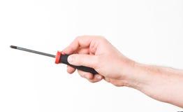 Hand met rood-zwarte schroevedraaier Royalty-vrije Stock Fotografie