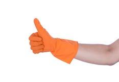 Hand met rubber oranje handschoen Royalty-vrije Stock Afbeelding