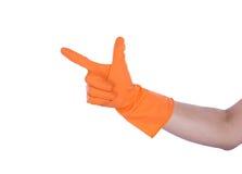 Hand met rubber oranje handschoen Royalty-vrije Stock Afbeeldingen