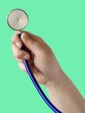 Hand met stethoscoop Royalty-vrije Stock Fotografie