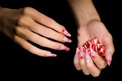 Hand met Suikergoed stock fotografie