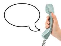 Hand met telefoon en toespraakbel Royalty-vrije Stock Foto's