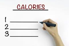 Hand met teller het schrijven - Calorieën lege lijst, fitness, sport, stock afbeelding