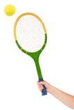 Hand met tennisracket en bal royalty-vrije stock foto's