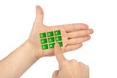 Hand met virtuele telefoonknopen stock foto
