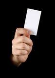 Hand met zwart adreskaartje Stock Fotografie