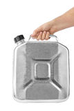 Hand with metal jerrycan Royalty Free Stock Photo