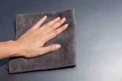 Hand with microfiber cloth Royalty Free Stock Photos
