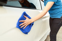 Hand with microfiber cloth cleaning car. Stock Image