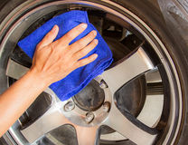 Hand with microfiber cloth cleaning car. Stock Images