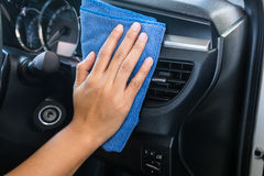Hand with microfiber cloth cleaning Interior Stock Image