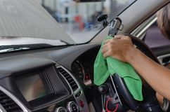 Wipe clean inside the car. Hand with Microfiber cloth to wipe clean inside the car royalty free stock image