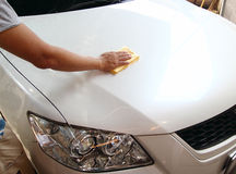 Hand with a microfiber wipe the car polishing Royalty Free Stock Photos