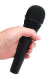 Hand with microphone. A hand holding a microphone on white background royalty free stock image