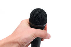 Hand with microphone Stock Images