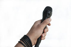 Hand with microphone. Related to the hand of the journalist with a microphone Royalty Free Stock Images