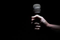 Hand and microphone Royalty Free Stock Photography