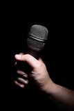 Hand and microphone stock image