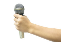 Hand with a microphone Royalty Free Stock Photo