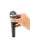 Hand with a microphone Stock Photos
