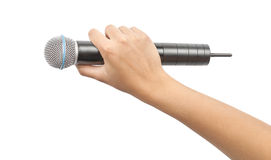 Hand with microphone isolated Stock Image