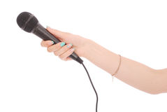 Hand with microphone. Isolated on white background royalty free stock image