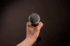 Hand with a microphone Royalty Free Stock Image