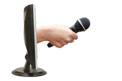 Hand with a microphone from the monitor Royalty Free Stock Photos