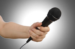 Hand with microphone Royalty Free Stock Photography