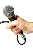 Hand and microphone Stock Images