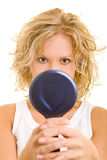 Hand mirror. Blonde woman looking in a hand mirror royalty free stock photography