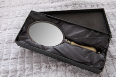 Antique Hand mirror. On a blanquette Stock Photos