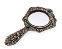 Hand mirror. Pictured hand mirror in a white background Stock Photography