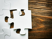 Hand with missing jigsaw puzzle piece. Business concept image for completing the final puzzle piece. Royalty Free Stock Photo