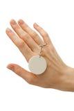 Hand mit Abzeichen Stockbild