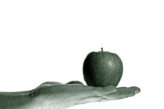 Hand mit Apfel Lizenzfreie Stockfotos