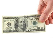 Hand mit Banknote $100 Lizenzfreies Stockbild