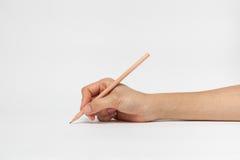 Hand mit Bleistiftschreiben etwas Lizenzfreies Stockbild